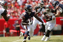Chicago's Tarik Cohen carries Sunday against Tampa Bay.