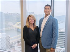 Lynette Horrell and Bill Schlegel are employed by Ernst & Young LLP, which offers a new program that encourages employees to reach out to co-workers who may be dealing with mental health issues.
