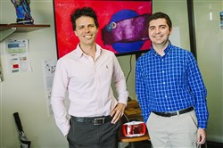 University of Pittsburgh Professor Jason Shoemaker, left, and student project manager Robert Gregg pose for a portrait on campus on September 21, in Oakland. The pair lead a team that created a VR game called vir-ed that allows biology and biochemistry students to virtually travel inside a blood vessel.