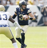 Pitt quarterback Ben DiNucci tries to shovel-pass past Georgia Tech defensive end Antonio Simmons in the first half Saturday at Bobby Dodd Stadium in Atlanta.