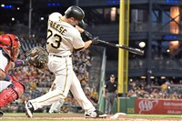 The Pirates' David Freese hits a single against the Cardinals in the first inning Saturday at PNC Park.