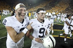 Quarterbacks Tommy Stevens, left, and Trace McSorley of the Penn State Nittany Lions celebrate after defeating the Iowa Hawkeyes on September 23, 2017 at Kinnick Stadium in Iowa City, Iowa.