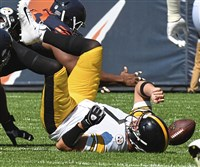Quarterback Ben Roethlisberger fumbles after being sacked, typical of the type of day it was Sunday for the Steelers at Soldier Field in Chicago.