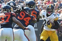 Le'Veon Bell rushes against the Bears on Sunday.