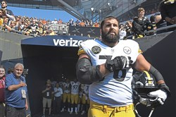 Alejandro Villanueva stands near the tunnel at Soldier Field during the playing of the national anthem before Sunday's game.