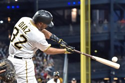 Pirates Elias Diaz hits a single against the Cardinals in the first inning Sept. 23 at PNC Park.