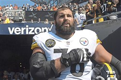 Steelers offensive lineman Alejandro Villanueva stands outside of the team tunnel Sunday during the National Anthem at Soldier Field in Chicago.
