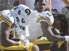 Antonio Brown, Martavis Bryant and JuJu Smith-Schuster react to losing to the Bears in overtime Sunday at Soldier Field in Chicago.