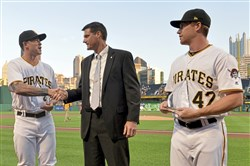 Larry Broadway, Pirates Director of Minor League Operations, congratulates Steven Brault for being named the organization's minor league pitcher of the year Sept. 23 at PNC Park in Pittsburgh. Jordan Luplow, right, won the minor league player of the year award.