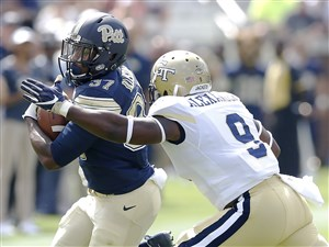 Pitt running back Qadree Ollison is tackled by Georgia Tech linebacker Victor Alexander in Saturday's 35-17 loss at Georgia Tech in Atlanta.