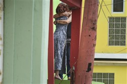 Residents in the La Perla community in Old San Juan comfort one another as the community in San Juan, Puerto Rico, recovers from Hurricane Maria on Sept. 25.