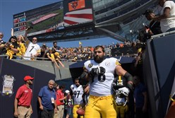 Steelers offensive lineman Alejandro Villanueva stands with his hand over his heart during the national anthem before the team's game Sunday in Chicago.