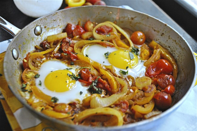 Golden Shakshuka is made with yellow bell peppers and yellow cherry tomatoes.