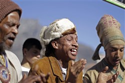 "In this 2012 file photo, men from the Khoisan ethnic group sing in Cape Town, South Africa, during an event unveiling a new suggested name by them for Cape Town, which translates as, ""Where the clouds gather."""