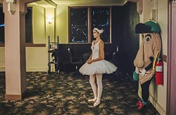 Sara Dierberger, 16, a pre-professional student with the Pittsburgh Ballet Theater and Pittsburgh Pirates Pierogi Jalapeno Hannah listen to a press conference about the Greater Pittsburgh Arts Council's latest economic impact study.
