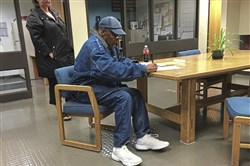 Free bird: O.J. Simpson signs documents at the Lovelock Correctional Center, Sept. 30.