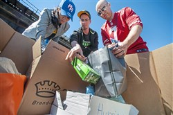 "From left: Puerto Rico natives Maria Abreau and Tyrone Medina, both 28 and of Jefferson Hills, work with Ted Koskoff, 36, of Allison Park, to sort donations collected for those affected by Hurricane Maria on Sunday at the Restaurant Depot parking lot in Lawrenceville. The collection happened in conjunction with the Clemente Museum's open house, which allowed the public to tour its memorabilia and archives for a donation to Clemente's native country. ""The biggest struggle right now is to find clean water to drink,"" said Ms. Abreau, whose family is dealing with the hurricane's aftermath after it destroyed their home and neighborhood in Puerto Rico. ""It's a lot of frustration, you can't do anything from here,"" she said."