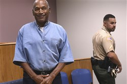 In this July 20 file photo, former NFL football star O.J. Simpson enters for his parole hearing at the Lovelock Correctional Center in Lovelock, Nev.