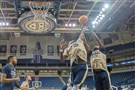 Peace Ilegomah, right, and Samson George battle for a rebound Oct. 5 at Petersen Events Center.