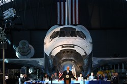 "CHANTILLY, VA - OCTOBER 05:  The Space Shuttle Discovery is the back drop as Vice President Mike Pence speaks during the inaugural meeting of the National Space Council on ""Leading the Next Frontier"" at the National Air and Space Museum, Steven F. Udvar-Hazy Center, October 5, 2017 in Chantilly, Virginia. Originally established in 1958, this is the first meeting of the newly reestablished council in 20 years.  (Photo by Mark Wilson/Getty Images) *** BESTPIX ***"