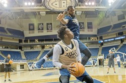 Khameron Davis pump fakes against Jared Wilson-Frame during practice Oct. 5  at Petersen Events Center.