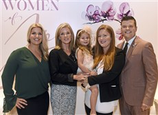 From left: Natalie Price, Carol D'Achille, Joy's daughter, Adriana, (held by) Christie Taggart, and Steven D'Achille, right.
