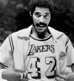 In this Nov. 2, 1973, file photo, Connie Hawkins shows off his new Los Angeles Lakers uniform before start of game against the New York Knicks in Inglewood, Calif.