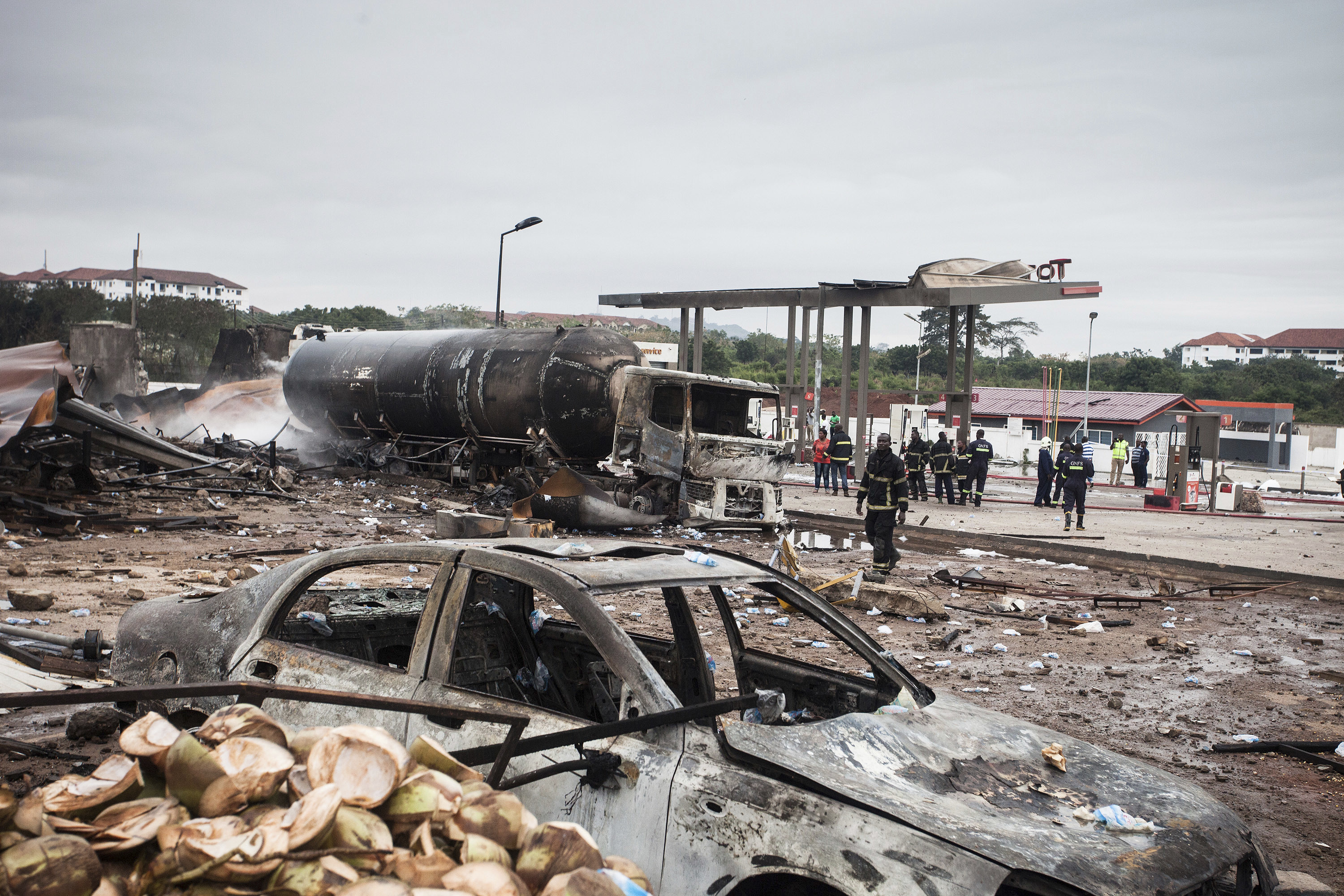 WEB APTOPIX Ghana Explosion Firemen at the site of Saturday's gas tanker explosion in Accra, Ghana.