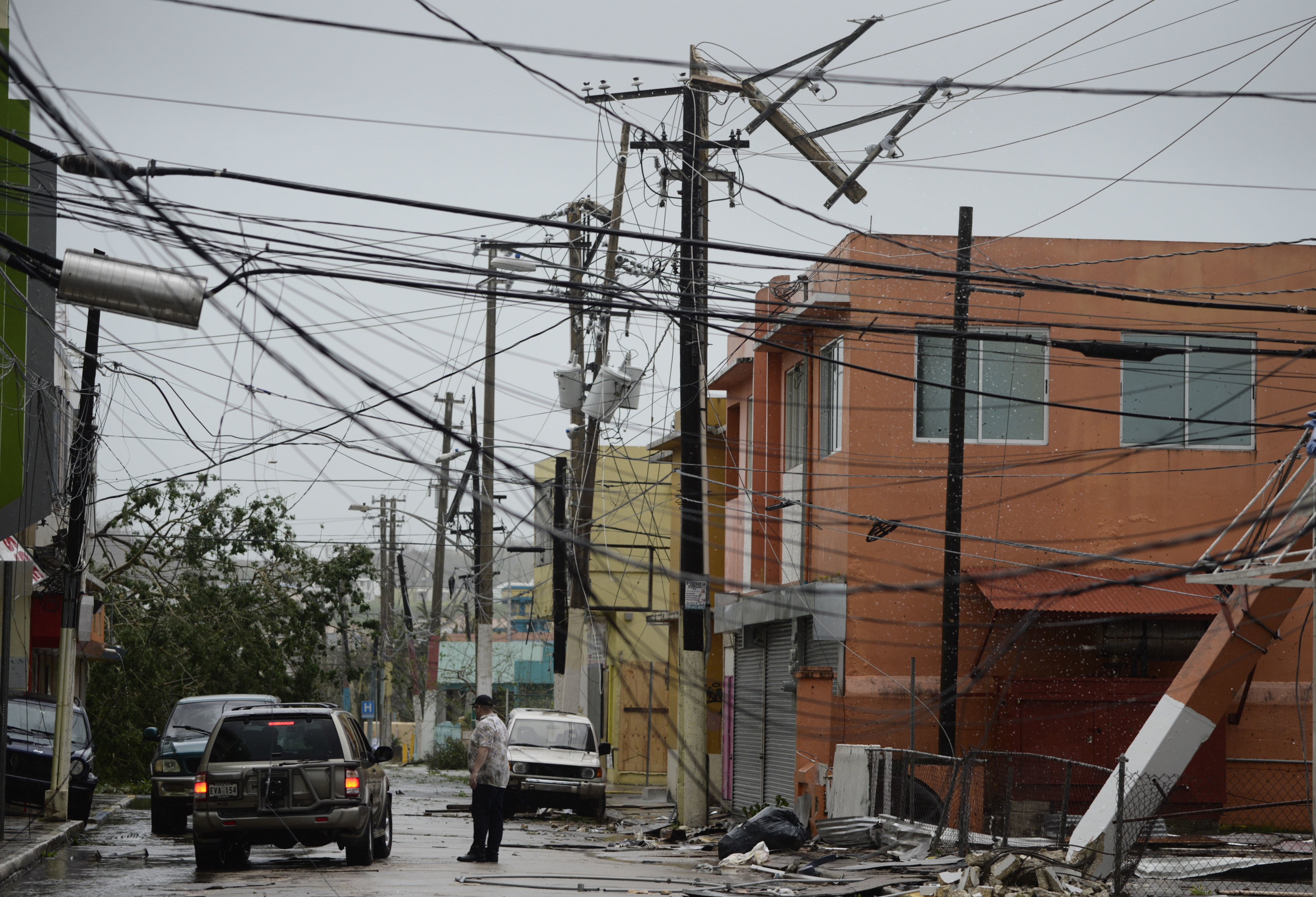 WEB Puerto Rico Tech Assistance In this Sept. 20 file photo, power lines are down after the impact of Hurricane Maria, which hit the eastern region of the island in Humacao, Puerto Rico.