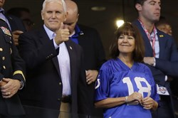 In this Oct. 8 file photo, Vice President Mike Pence reacts to fans before an NFL game between the Indianapolis Colts and the San Francisco 49ers in Indianapolis.