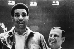 Connie Hawkins holds his ABA MVP award with coach Vince Cazzetta.