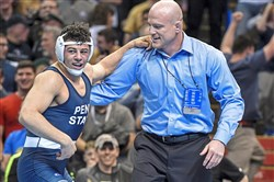 Vincenzo Joseph celebrates with Penn State coach Cael Sanderson after Joseph won an NCAA championship.