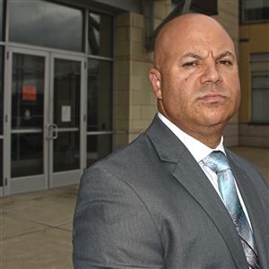 "Pittsburgh Police Cmdr. Victor Joseph, who oversees the major crimes squad, credits targeted efforts with helping to reduce gun violence in the city in 2017 over a year earlier. ""It's like a scalpel removing the problem rather than a machete,"" Cmdr. Joseph said. He is seen here last year outside police headquarters on the North Side."