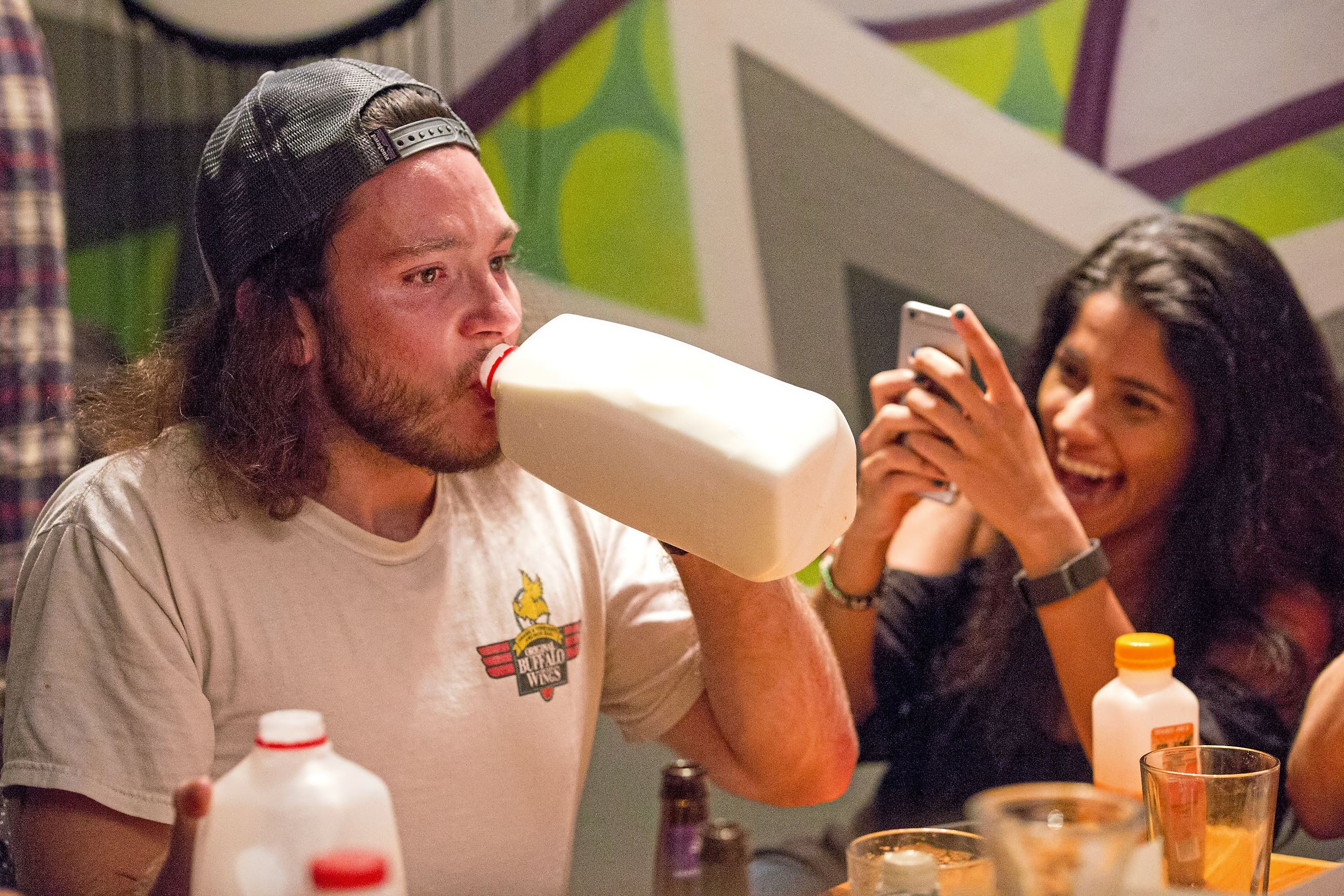 """20171010acMeltYoFaceOff06-1 Nichola Long, of South Side, chugs milk after eating a wing during the """"Melt Yo Face Off"""" event at Streets on Carson where each participant endured eleven levels of hot sauce until they reached the hottest one, The Last Dab on Tuesday."""
