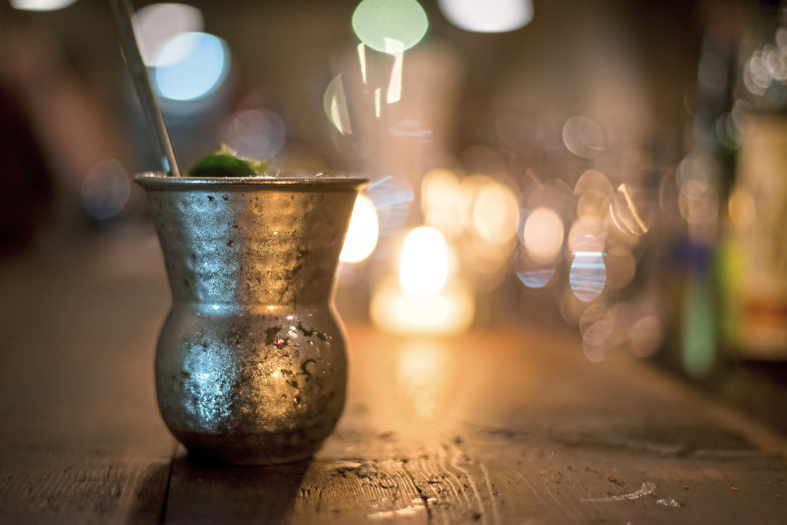 20171010smsOysterCo09-5 The Holywater, a take on the tiki drink, is served in a chalice-like metal cup with a metal straw at Merchant Oyster Co.