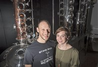 Owners Ryan and Sarah Kanto pose for a portrait with their still at Quantum Spirits distillery in Carnegie.