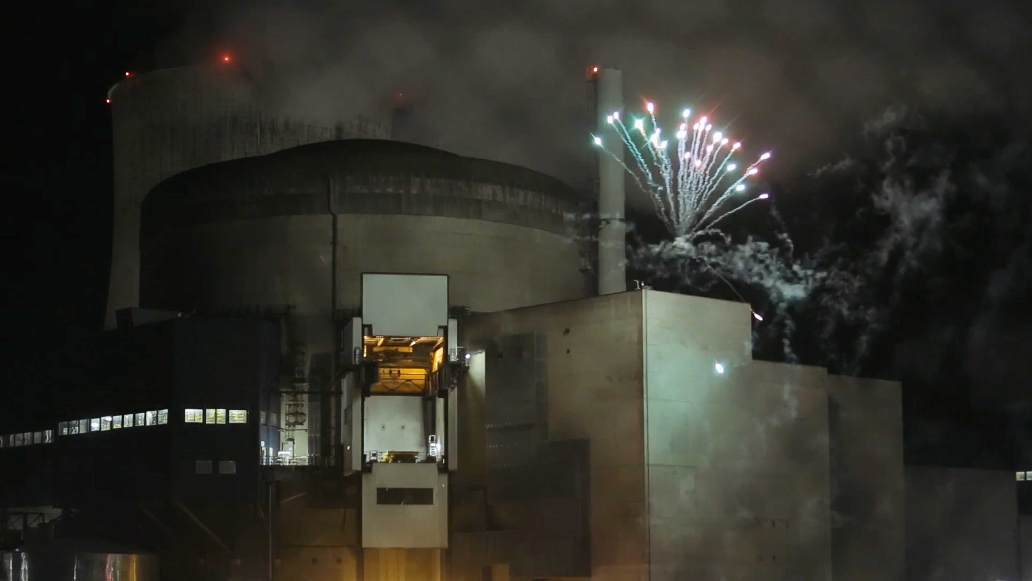 France Nuclear-1 In this photo provided by Greenpeace France and dated Thursday, Oct. 12, 2017, Greenpeace activists set off fireworks inside the nuclear power plant of Cattenom, eastern France. Eight environmental activists are in custody after breaking into a French nuclear power station and setting off fireworks, in a bid to urge better protection for nuclear waste and protest France's dependence on atomic energy. (Greenpeace via AP)