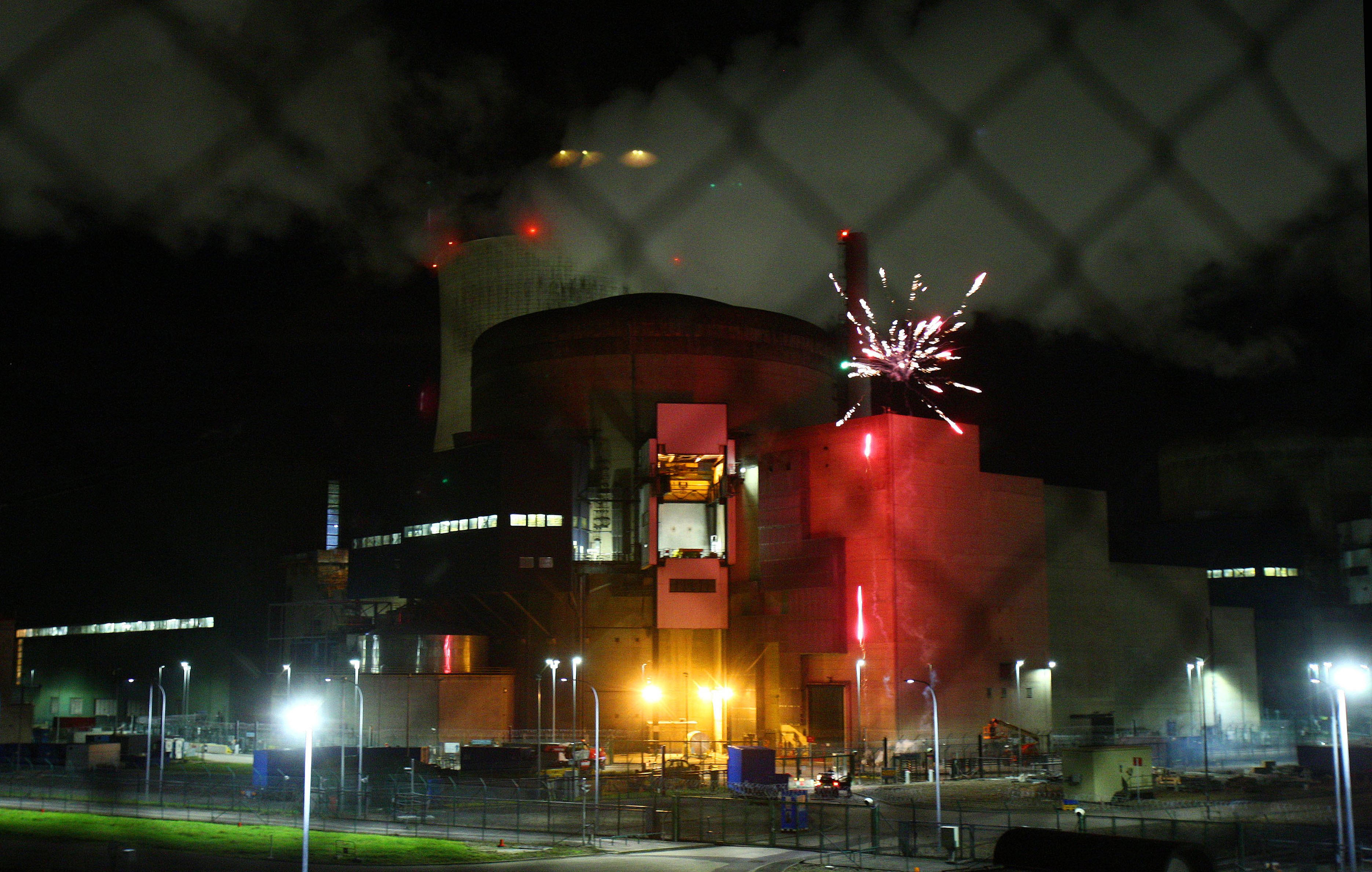 France Nuclear In this photo provided by Greenpeace France and dated Thursday, Oct. 12, 2017, Greenpeace activists set off fireworks inside the nuclear power plant of Cattenom, eastern France. Eight environmental activists are in custody after breaking into a French nuclear power station and setting off fireworks, in a bid to urge better protection for nuclear waste and protest France's dependence on atomic energy. (Greenpeace via AP)