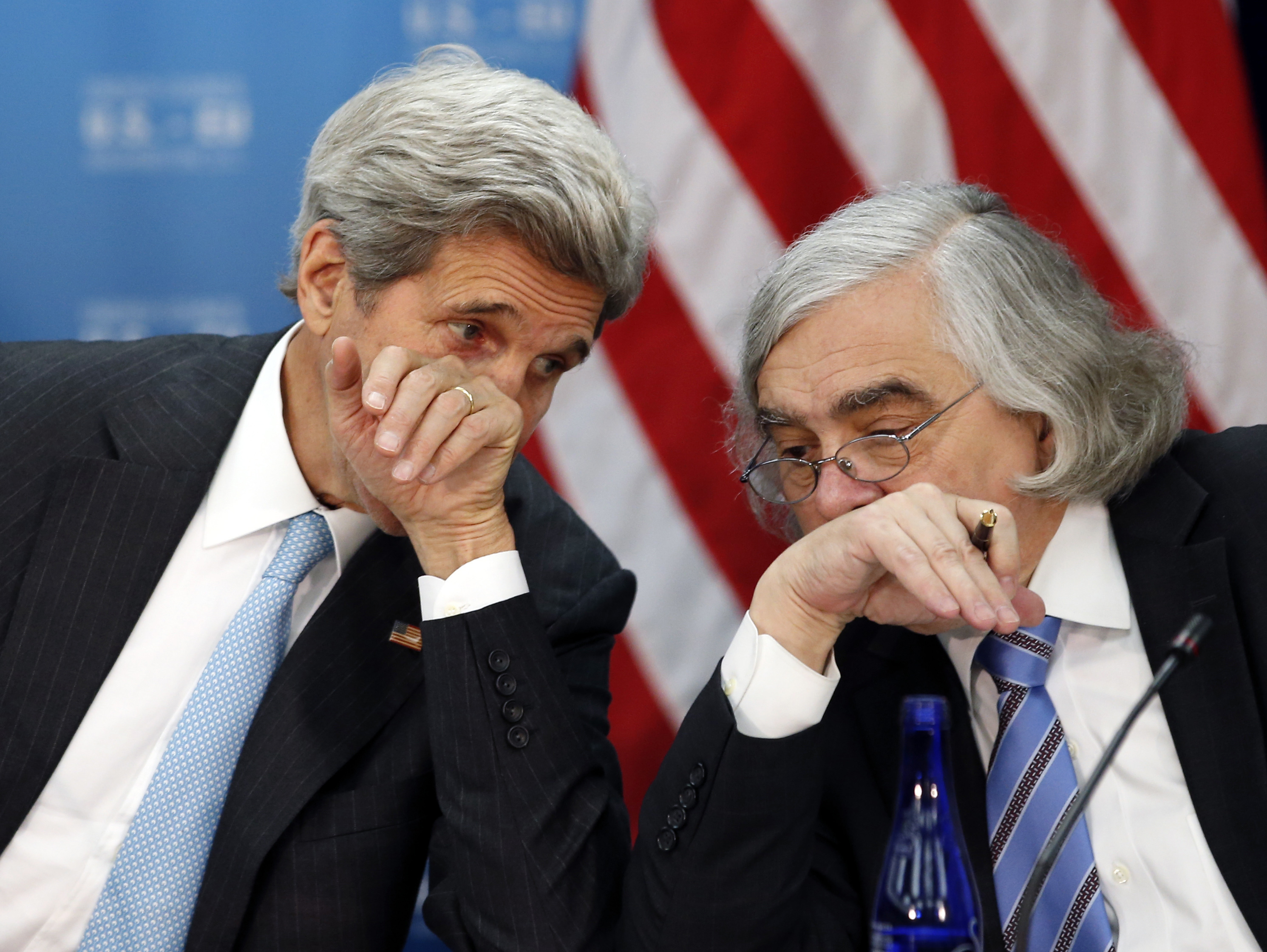 US Iran FILE - In this May 4, 2016 file photo, Secretary of State John Kerry, left, speaks with Secretary of Energy Ernest Moniz at the State Department in Washington. Former Obama administration officials who played central roles in brokering the Iran nuclear agreement are scheduled to brief congressional Democrats on the merits of the international accord as President Donald Trump prepares to announce a decision that could lead to an unraveling of the pact. (AP Photo/Alex Brandon)