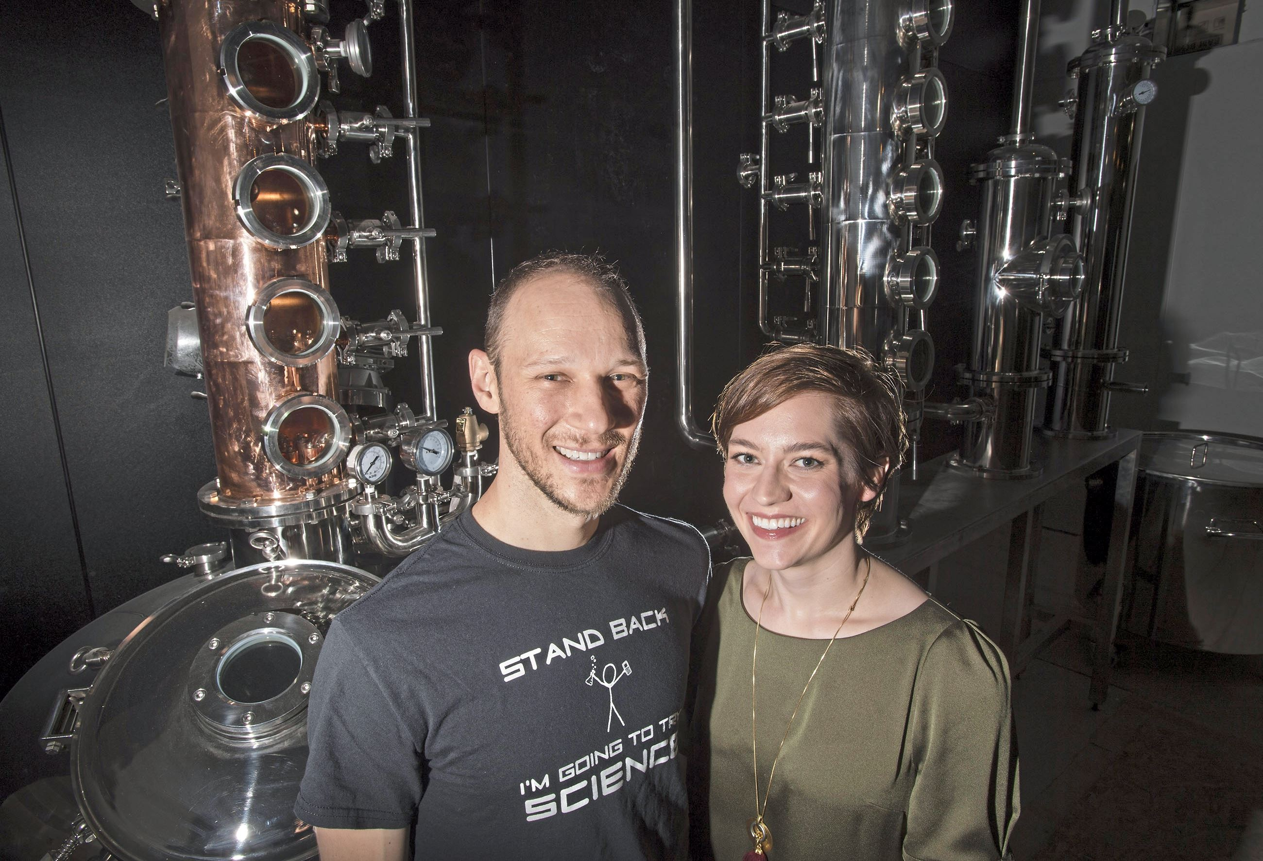 20171012scCarnegie21-1 Owners Ryan and Sarah Kanto pose for a portrait with their still at Quantum Spirits distillery in Carnegie.