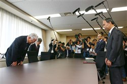 "Kobe Steel President Hiroya Kawasaki (L) bows to economy, trade and industry officials during a meeting at the ministry in Tokyo on October 12, 2017. The head of Japan's Kobe Steel warned on October 12 that a quality control scandal engulfing his firm was likely to widen at home and abroad, as he acknowledged that trust in the steelmaker has ""fallen to zero"".   JAPAN OUT / AFP PHOTO / JIJI PRESS / STR / Japan OUTSTR/AFP/Getty Images"