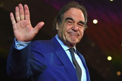 Oscar-winning U.S. filmmaker Oliver Stone poses on the red carpet during the opening ceremony of the 22nd Busan International Film Festival (BIFF) at the Busan Cinema Center in Busan on October 12, 2017.