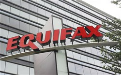 This 2012 file photo shows signage at the corporate headquarters of Equifax Inc. in Atlanta.