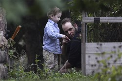 In this file photo, Joshua Boyle and son Jonah play in the garden at his parents house in Smiths Falls, Ont., on Oct. 14, 2017.