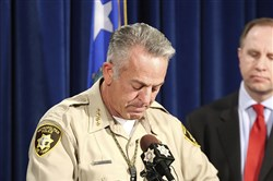 In this file photo, Clark County Sheriff Joe Lombardo left, pauses during a news conference at the Metropolitan Police Department in Las Vegas as FBI special agent Aaron Rouse, right, looks on Oct. 13, 2017.