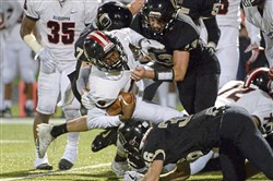 Aliquippa's William Gibson is brought to the ground by Quaker Valley defense on Friday.