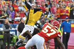 Chiefs Kevin Pierre-Louis upends Pittsburgh Steelers Antonio Brown Sunday, October 15, 2017, at Arrowhead Stadium Kansas City Missouri.