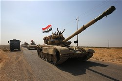 Iraqi forces drive towards Kurdish peshmerga positions on October 15, 2017, on the southern outskirts of Kirkuk.