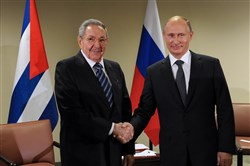 In this September 28, 2015 file photo, Raul Castro, left, president of Cuba, and Russia's President Vladimir Putin shake hands at a meeting on the sidelines of the 70th session of the United Nations General Assembly in New York.