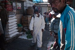In this October 10, 2017, file photo, council workers spray disinfectant as they clean-up the market of Anosibe in the Anosibe district, one of the most unsalubrious district of Antananarivo.